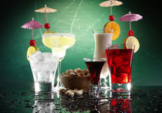 4 happy umbrella drinks and pistachio. Martini, Margarita, Fizz and Colada Royalty Free Stock Photography