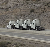 4 humped trucks towing Royalty Free Stock Photo