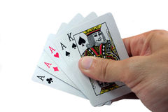 4 of a Kind. Hand with  playing cards on white Stock Image