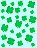 4 Leaf Clovers. Four Leaf clovers on a blue background Royalty Free Stock Photography