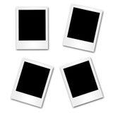 4 lege fotoframes op wit Stock Fotografie