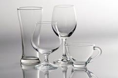 4 lege glazen in verschillende stijl Stock Foto's