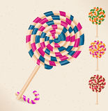 4 lollipops and a candy cane Stock Photos