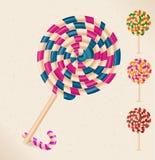 4 lollipops y un bastón de caramelo Fotos de archivo