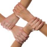4 mani connesse Fotografia Stock