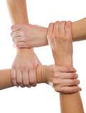 4 manos conectadas Foto de archivo libre de regalías