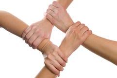 4 manos conectadas foto de archivo