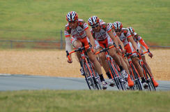 4 Men at Road during Daytime Performing Road Bike Racing Royalty Free Stock Photography