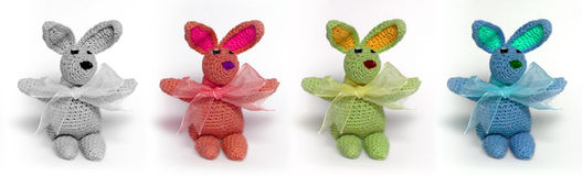 4 multicolored little rabbits Stock Image