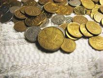 4 mynt Arkivbild
