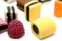 4 olika sötsaker för frukt för drevkarlfärgdatalista Royaltyfria Bilder