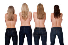 4 partes traseiras e calças de brim Fotografia de Stock Royalty Free