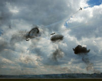 4 Planes with smoke. 4 military planes with smoke from simulated bombs stock image