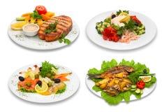 4 pratos de peixes imagem de stock