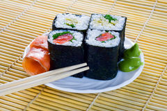 4 rolls of sushi with fish. On the bamboo Royalty Free Stock Photo