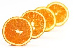 4 sinaasappelen Stock Foto's