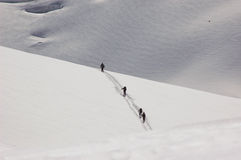 4 Skieurs Crossing a Shoulder of the Mt Blanc. 4 Skiers passing over a shoulder of the Gros Rognon, on the Mt Blanc in France. The shot is enhanced by the Royalty Free Stock Images
