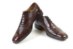 4 skor för man s Arkivfoto