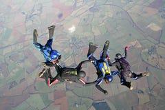 4 skydivers freefall Стоковая Фотография RF