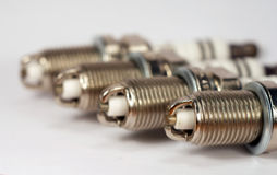 4 spark plugs. Four spark plugs on white background Royalty Free Stock Image