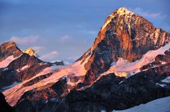 4 Swiss Giants at sunset. The Dent Blanche( largest and right), Grand Cornier (left), Weisshorn (second from left), Zinal Rothorn (3rd from left) at sunset as Royalty Free Stock Image
