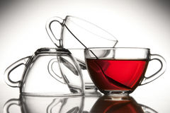 4 tea cups and tea Royalty Free Stock Photography