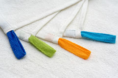 4 Towel. Four white towels with color hangers Stock Photos