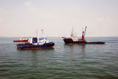 4 tug boats Singapore anchorage. Royalty Free Stock Image