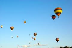 4 varma luftballonger Arkivbild