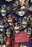 4 venetian karnevalmaskeringar Arkivfoton