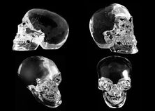 4 views of a crystal skull. On a black background royalty free illustration