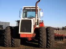 4-Wheel Drive Tractor 2. Front view of a 4-wheel drive farm tractor. Disc and fencelines in background Stock Photos