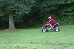 4-wheeling. A person on an ATV, motion blur Stock Images