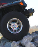 4 Wheeling. Truck climbing hill of rocks Stock Photos