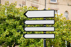 4 white guide sign in town Stock Photo