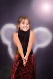 4 Year Old Angel. A young girl dressed in wings pretending to be an angerl Royalty Free Stock Photography