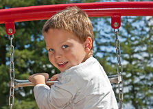 4 Year Old Boy on Playground Equipment Stock Photography