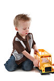 4 Year Old Boy Plying with Yellow School Bus Toy Stock Photography