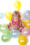 4 Year Old Girl Looking Up with Balloons