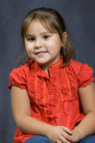 4 Year Old Portrait. A four year old girl sitting getting her portrait done Stock Photography