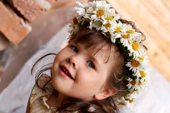 4 years old girl in circlet. Of flowers Royalty Free Stock Photos