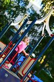 4 years old girl on playground Royalty Free Stock Image