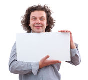 40 year old man holding a white board Stock Photography