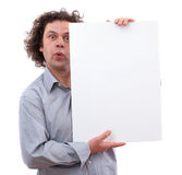 40 year old man holding a white board Royalty Free Stock Image