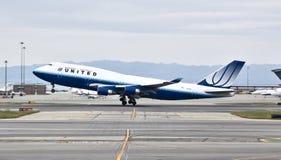 400 747 förenade boeing Arkivfoto