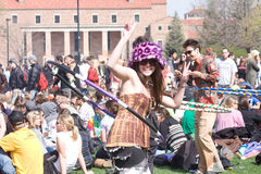 420 Event Hula Hoop Girl. Girl giving a peace sign while hula hooping at the 420 day even at the University of Colorado Stock Image