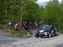42nd Rally of Aosta Valley. Car number 10 (Ford Fiesta) face an hairpin bend in Fenis' stage of 42nd Rally of Aosta Valley in 2012 on April the 27th/28th Stock Image