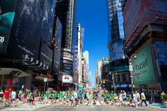 42nd Street. New York, New York, USA - July 6, 2012: Busy intersection at 42nd St. and Broadway near Times Square with pedestrian's crowds in a sunny day Royalty Free Stock Photo
