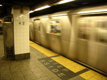 42nd street subway. Subway train pulling into 42nd street station, New york stock photos