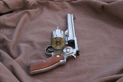 44 magnum. Single shot revolver with ammo showing stock photography
